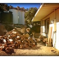 dec152013just-set-up-the-bad-ass-firewood-rack-no-tools-needed-and-loading-it-up