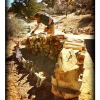 feb9jon-workin-on-his-log-ness-monster-firewood-wall